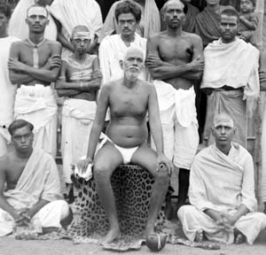 Annamalai Swami, top left, with Bhagavan in the 1930s