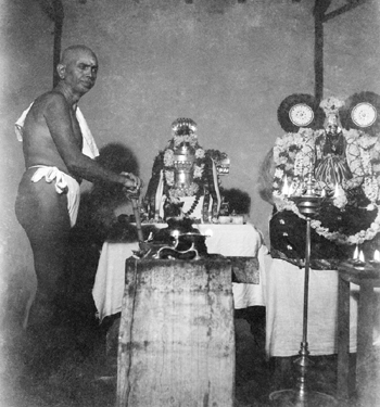 Bhagavan inside the Mother's Samadhi in the 1930s
