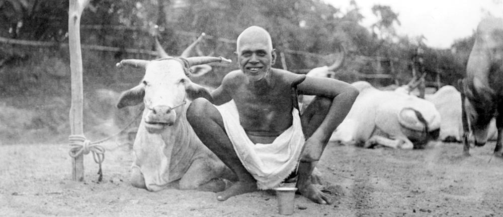 Bhagavan squatting with Lakshmi