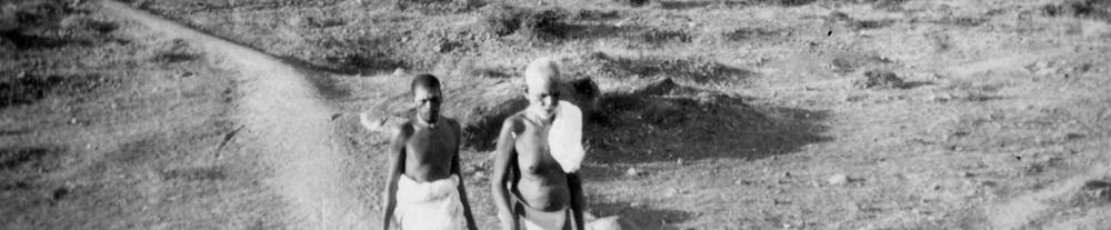 Bhagavan walking on Arunachala with his attendant.