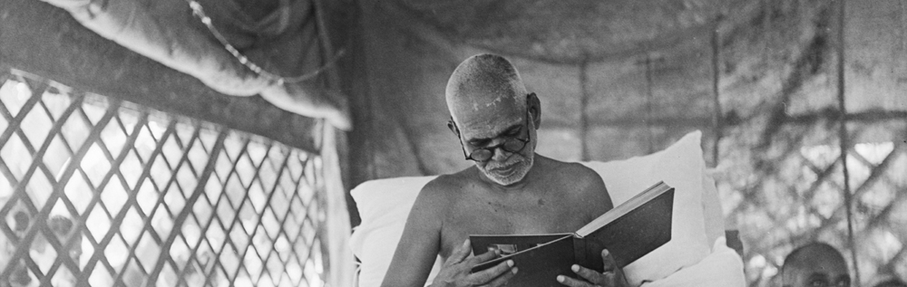 Bhagavan reading in the Jubilee Hall