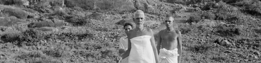 Bhagavan walking on the hill with his attendant