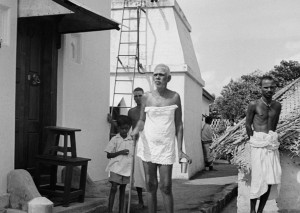 Annamalai Swami, Madhava Swami and Bhagavan putside Bhagavan's bathroom in the 1930s