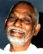 Lakshmana-Swamy-smiling-sli