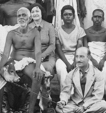 Paul Brunton sitting with Bhagavan around 1930.