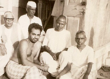 An early photo of Maharaj, second from the right