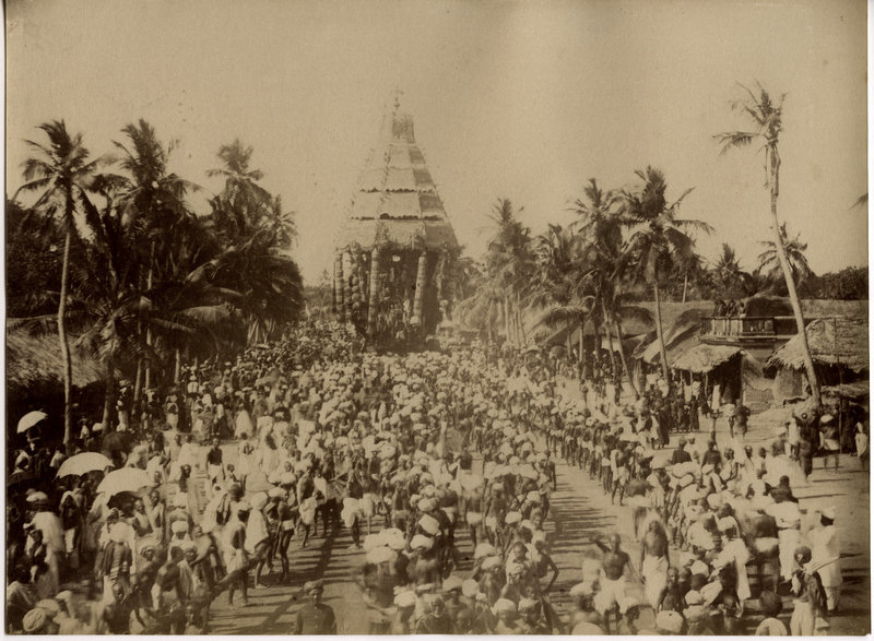 This is the oldest known photo of Tiruvannamalai. It is the start of the Big Car procession in 1880. It is taken from the end of Car Street on the junction of Tiruvoodal Street. The two lines of devotees are about to begin pulling the cahariot clockwise around the Arunachalewara Temple.