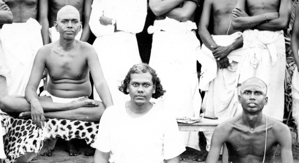 Muruganar (right) sitting with Bhagavan