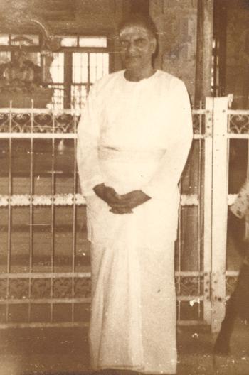 Papaji in front of Ramana Maharshi's samadhi, 1981
